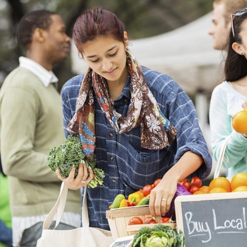woman buying food at farmer's market